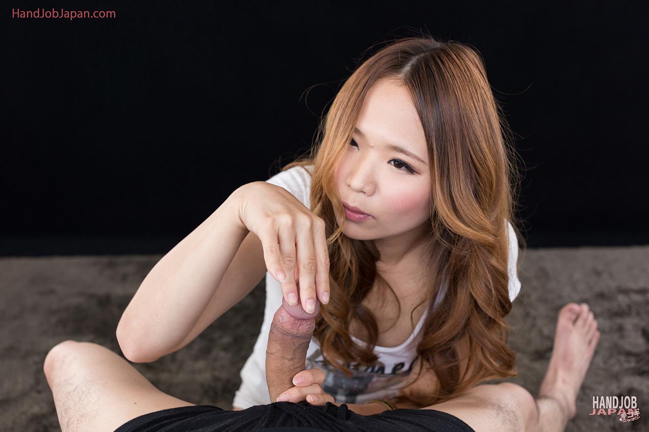 asian girl is doing handjob